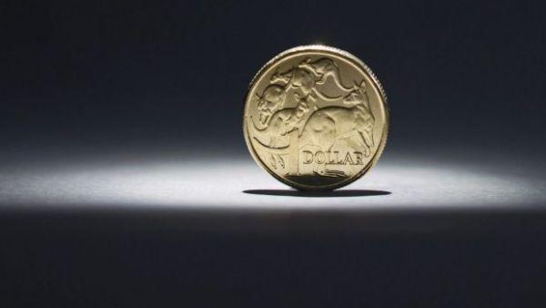 Australian dollar hits highest mark since June as risk tolerance rises