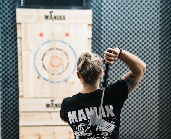 """It really adds to the atmosphere"": Axe-throwing clubs want to serve alcohol"