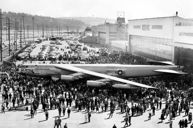 The first B-52A is rolled out at Boeing's Seattle plant on March 18, 1954. In order to clear the hangar doorway, the plane's 48-foot-high tail had to be folded down. U.S. Air Force photo.