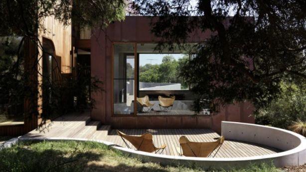 Curves: Bluff House's concrete turret area leads into a painting studio. Photo: Trevor Mein, Auhaus Architecture