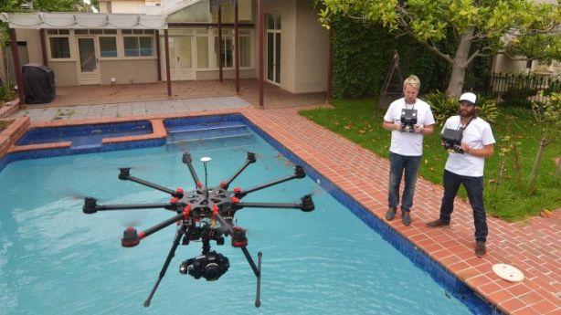 Tim Shaw, photographer and Will Brown, chief UAV controller. Photo: Joe Armao