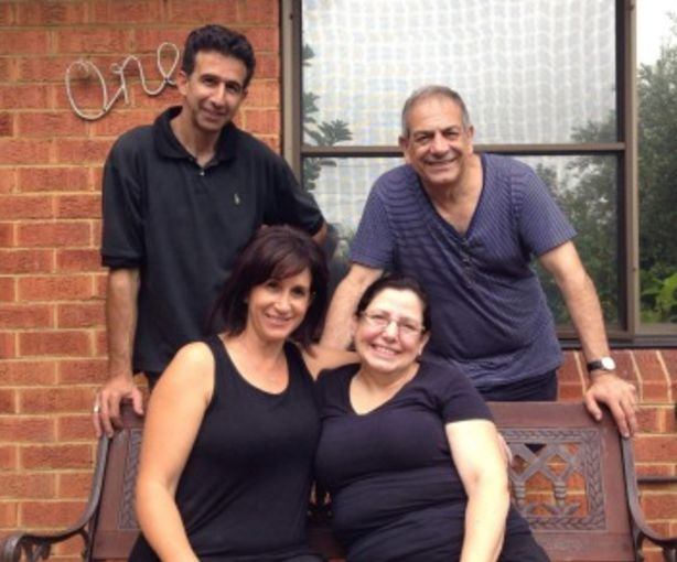 Auntie Elsie's nephews and nieces, Zacharia Zacharia and Michael Zacharia, and Lia Gioulis and Sue Costi. They have been working on Auntie Elsie's garden, which had become overgrown. Photo: Supplied