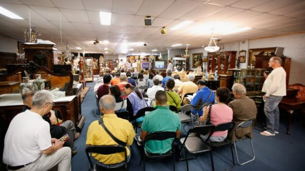 Christian McCann auction off items at a French furniture auction in Melbourne, Victoria. Photo: Darrian Traynor