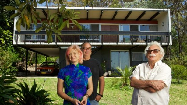 Home owners Sarah Keighery and Billy Gruner with architect Nino Sydney outside their winning beachcomber house, which Nino designed in 1961. Photo: Wolter Peeters