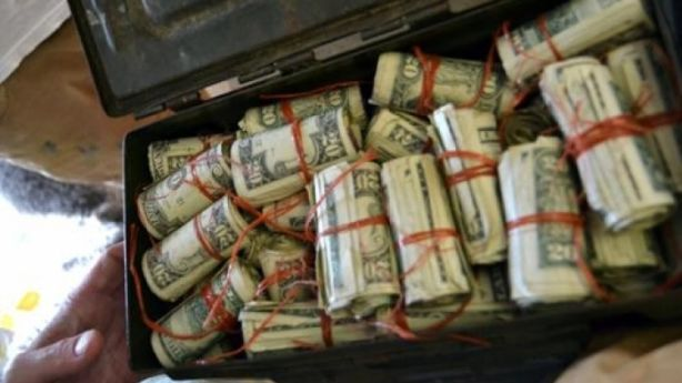 Couple moving into their new home find thousands of dollars hidden in box in attic. Photo: AP Images