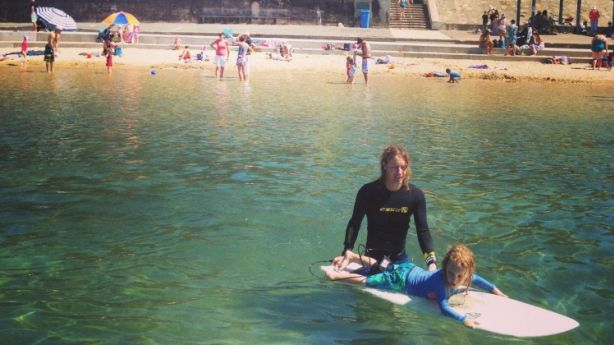 Outdoor lifestyle: Laura Jackel's husband, Julian, and son, Toby, surf at Merewether baths in Newcastle.