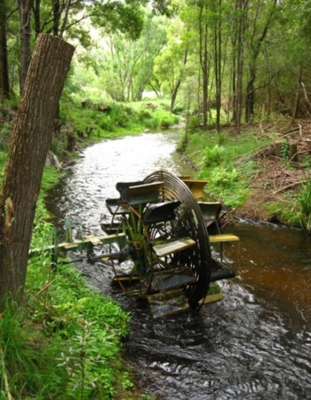 A waterwheel on Jill Redwood's property.