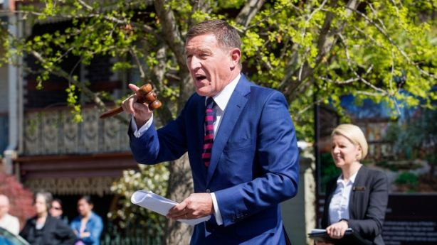 Agent and auctioneer Antony Woodley of Collins Simms Real Estate in action last month. Photo: Paul Jeffers