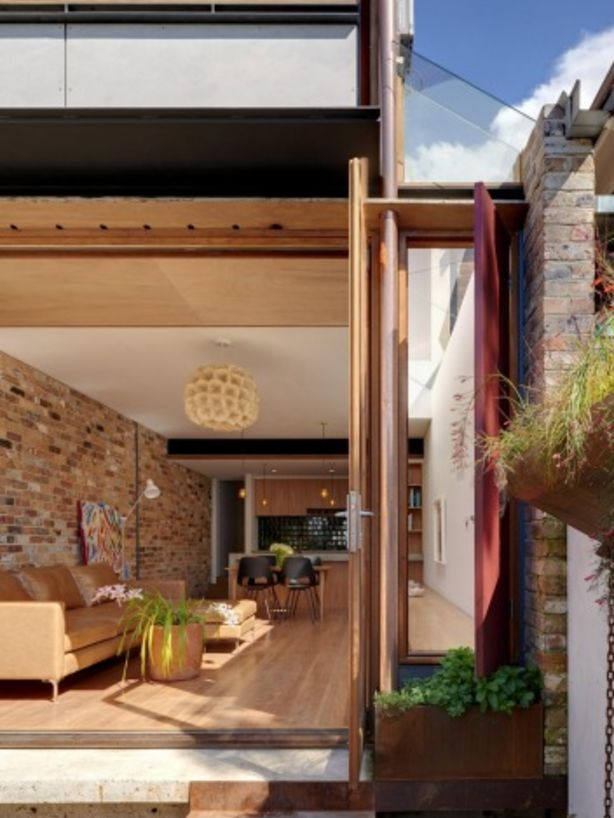 The living/dining and kitchen space opens to  a sunny private courtyard. Photo: Michael Nicholson