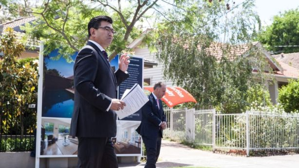 Auctioneer Robert Ding asked the crowd for permission to translate the bids into Mandarin at the auction of 10 Westley Street, Hawthorn East. Photo: Alistair Walsh