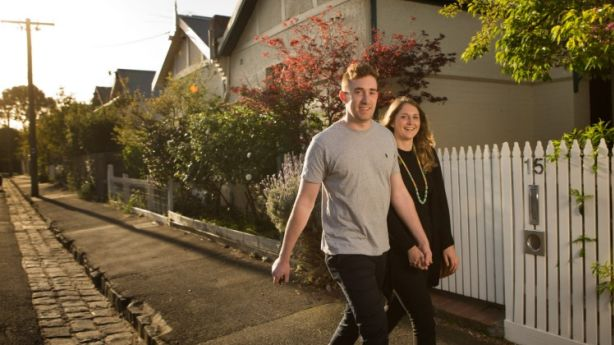 Grace Billing, 24, and boyfriend James Saunders, 22, outside a property they're inspecting to rent. Photo: Simon Schluter