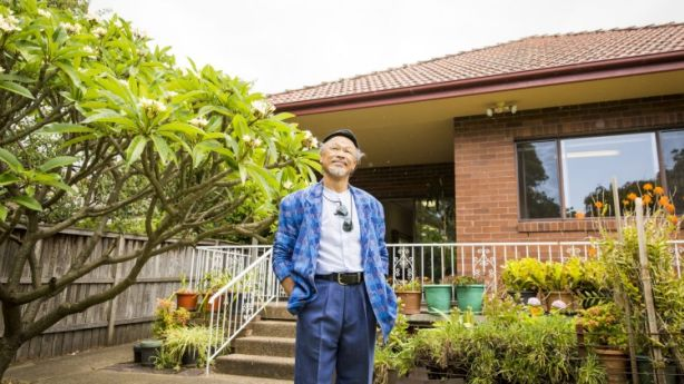 Reasons to be cheerful: Seller, Lawrence Tong outside his family home in Kensington. Photo: Anna Kucera