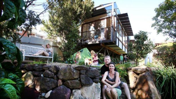 Wonoona couple Sam and Katrina Gill in front of The Pod, designed by TAKT architects. Photo: Sylvia Liber