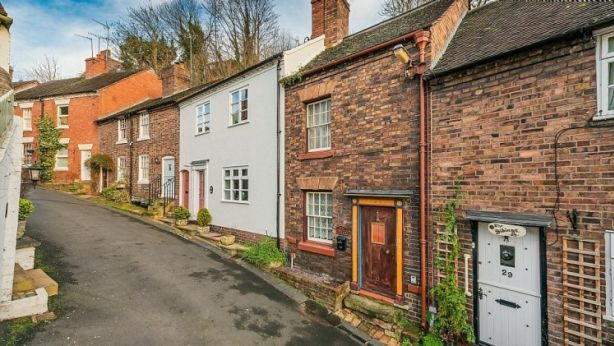 This cottage, second right, in Shropshire, England, has a big sandstone secret. Photo: Nock Deighton