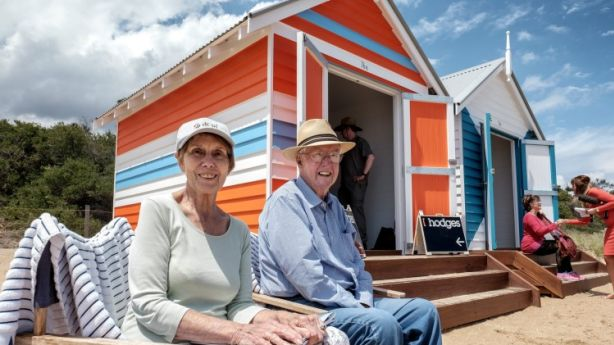 Walter and Helen Gibson are the new owners of a Dendy Beach box in Brighton, beating three other bidders for the keys. Photo: Luis Ascui