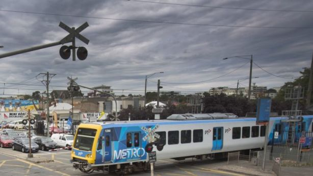 Boom gates and rail and road traffic are commonplace for some Melburnians. Photo: Simon O'Dwyer