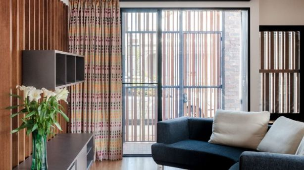 Philip Harmer has created a vibrantly modernist living room that suggests a stage set. Photo: Supplied