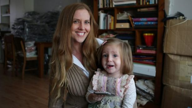 Natasha - pictured with her daughter, Birdie - has started her own business from home. Photo: John Veage