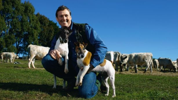 The late interior designer Stuart Rattle with his fox terriers at Musk Farm in Daylesford. Photo: Eamon Gallagher