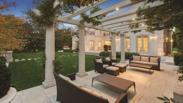 At 4 Robertson Street in Toorak, the gardens, including a 25-metre pool and spa, were designed by Paul Bangay. The interiors were designed by Thomas Hamel. Photo: Supplied