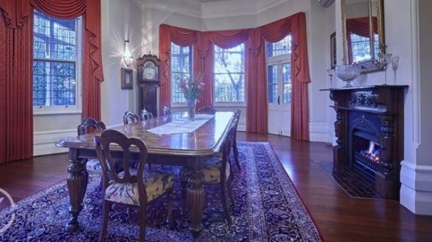 The formal dining room can easily seat 14. Photo: Caporn Young