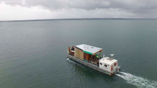 The five sections of the prefabricated home were transported to the island over three days. Photo: Supplied.