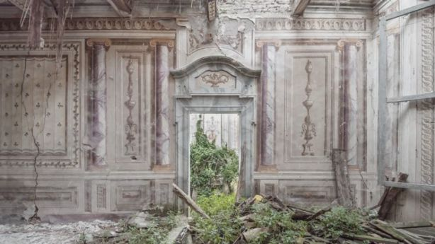 The crumbling walls and faded frescoes in the rooms of the villa contrast with the twisting roots and vegetation. Photo: Mirna Pavlovic