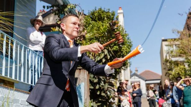 Auctioneer Damian Cooley selling 3 Sardinia Place, Birchgrove, on a weekend that saw the city's clearance rate hit 85.1 per cent. Photo: Brook Mitchell