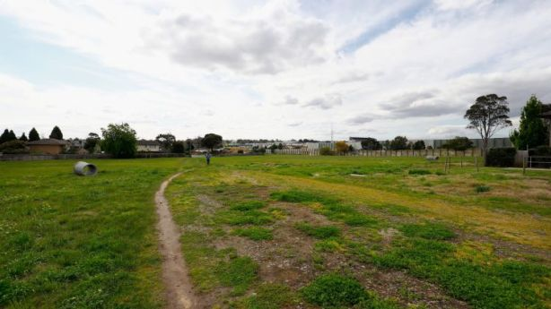 This vacant land in Mulgrave is used as a pedestrian connection between the shopping centre and their residential neighbourhood. Photo: Darrian Traynor