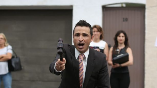 Auctioneer Vic Lorusso at the auction of 12 Waiwera Street, Lavender Bay. Photo: James Alcock
