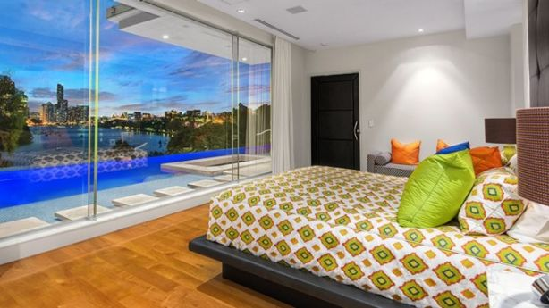 Even the bedrooms have stunning city and river views.
