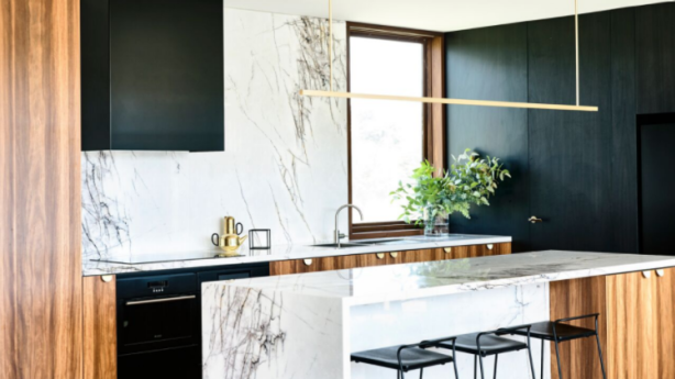 Sharp-veined marble benches in the kitchen evoke the branches of cypress trees outside. Photo: Derek Swalwell
