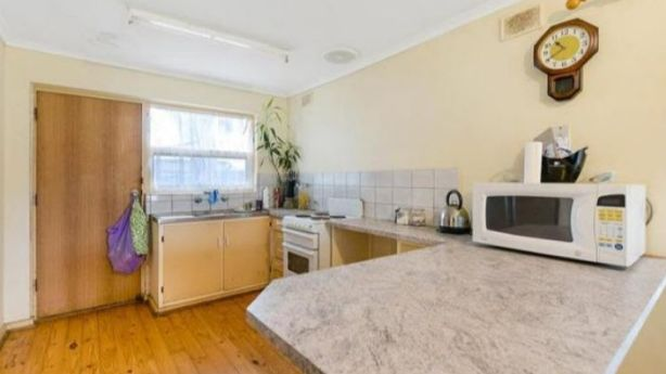 Before: The kitchen in the Salisbury house needed a quick renovation, including new floating laminate floorboards, new kitchen cabinetry and appliances, new splashback and sink to a total cost of $3000.