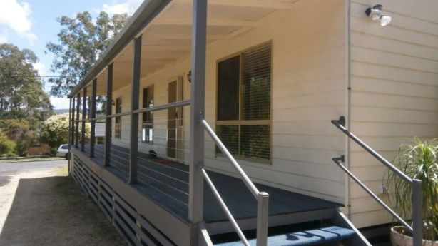 A newly renovated three-bedroom home at 20 Abbott Street, Nabiac, with a large north-facing covered balcony and a separate studio with bathroom for $349,000.