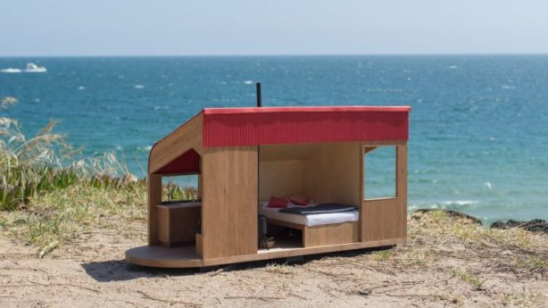 This 12-volt solar-powered Tiny House sleeps two and comes with a kitchen sink and hot shower. Photo: Shacky, design by MvS Architects