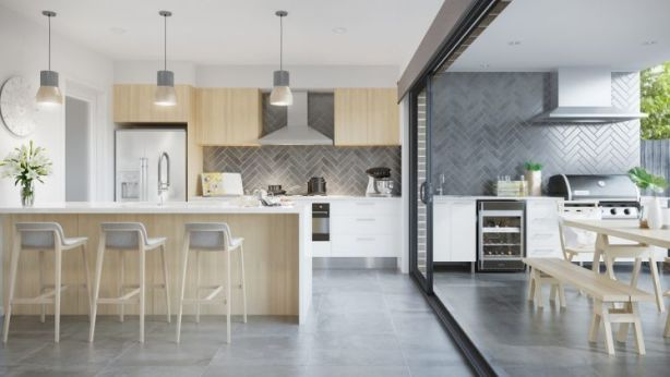 The large living, dining and kitchen space at the rear  flows into an al-fresco dining area. Photo: Supplied