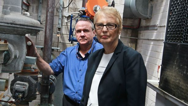 Michael Heaney and Barbara Richards, who live in an apartment block in Kent Street, in Sydney, received a massive gas bill from AGL. Photo: Ben Rushton