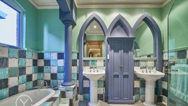 The wet areas have handmade, handpainted Italian tiles. Photo: Supplied
