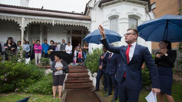 Auctioneer Jesse Davidson of AuctionWorks at the auction of 5 George Street, Marrickville. Photo: Fiona Morris