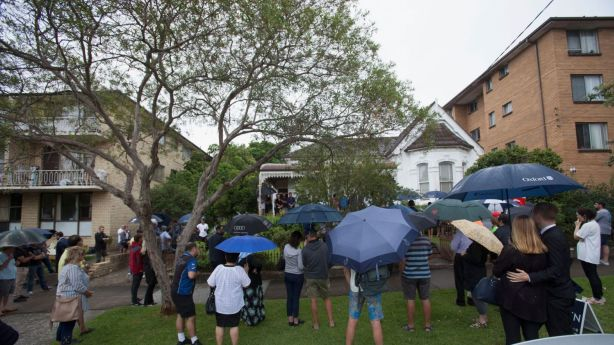 A large crowd braved the rain for the auction of the Marrickville home which has been held by the one family for more than 90 years. Photo: Fiona Morris