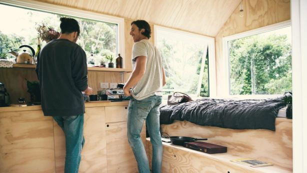 The solar-powered tiny homes are about 15 square metres and have a gas stove, bar fridge, hot shower.