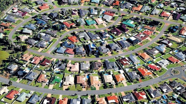 The attraction to Australia is being driven in part by the cost of buying property in its major cities compared with other urban centres around the world. Photo: Glen McCurtayne