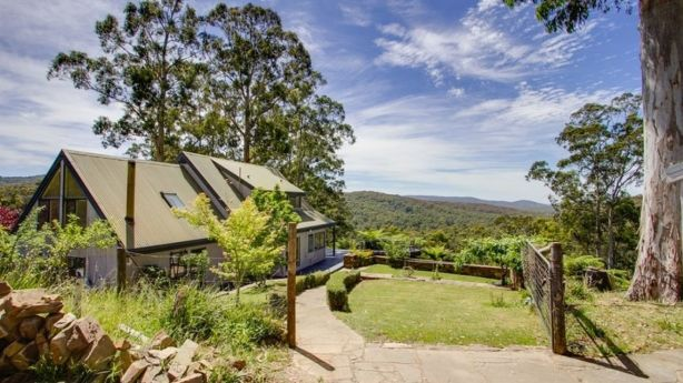 This chalet-style home, in Gembrook-Tonimbuk Road, is on 57 acres of land and sold for $791,000 earlier this year. Photo: Bell Real Estate