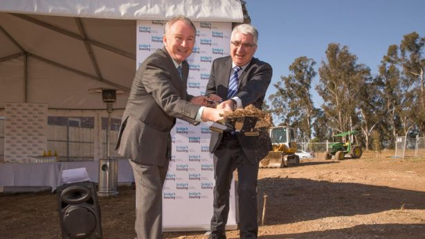 Bridge Housing CEO John Nicolades (right) pictured turning the first sod at the Bungarribee site with Riverstone MP Kevin Conolly in 2015, believes a direct subsidy is needed to encourage investment in affordable housing. Photo: Geoff Jones