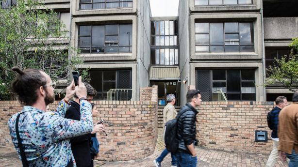 Architects on a tour with the architect of the Sirius building, most of whom want to preserve the building as an example of brutalistic architecture. Photo: Louie Douvis