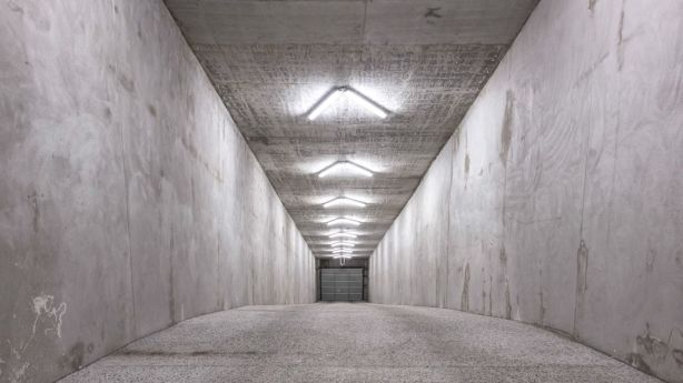 The Batcave-like tunnel which spans 50 metres and leads to a 10-car garage at 128 Crosby Road, Ascot. Photo: Supplied