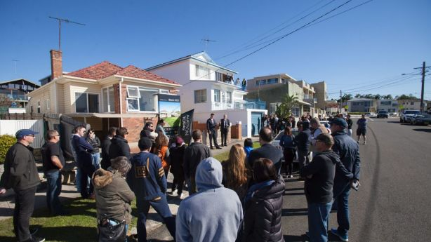 About 80 people gathered for the auction of a beachfront Malabar home on the market for the first time in more than 60 years. Photo: Fiona Morris.