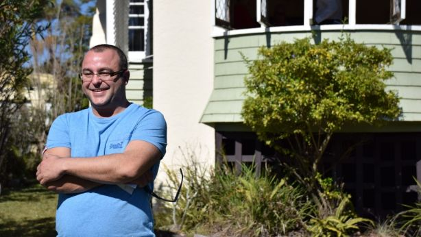 Anthony standing out the front of his new home. Photo: Jim Malo