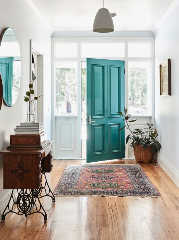 The farmhouse teal door. It's thought to be the same teal colour in which the original door was painted. Photo: Eve Wilson. Production: Lucy Feagins/The Design Files