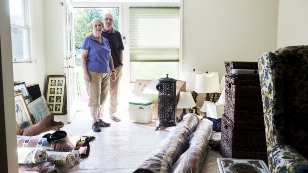 Tena and Ray Bluhm in their new home in the Westminster retirement community in Lake Ridge, Virginia, USA. The Bluhms moved in to their new home in early August, and needed to sort through items to determine what they needed and could fit in the smaller space. Photo: T.J. Kirkpatrick for The New York Times
